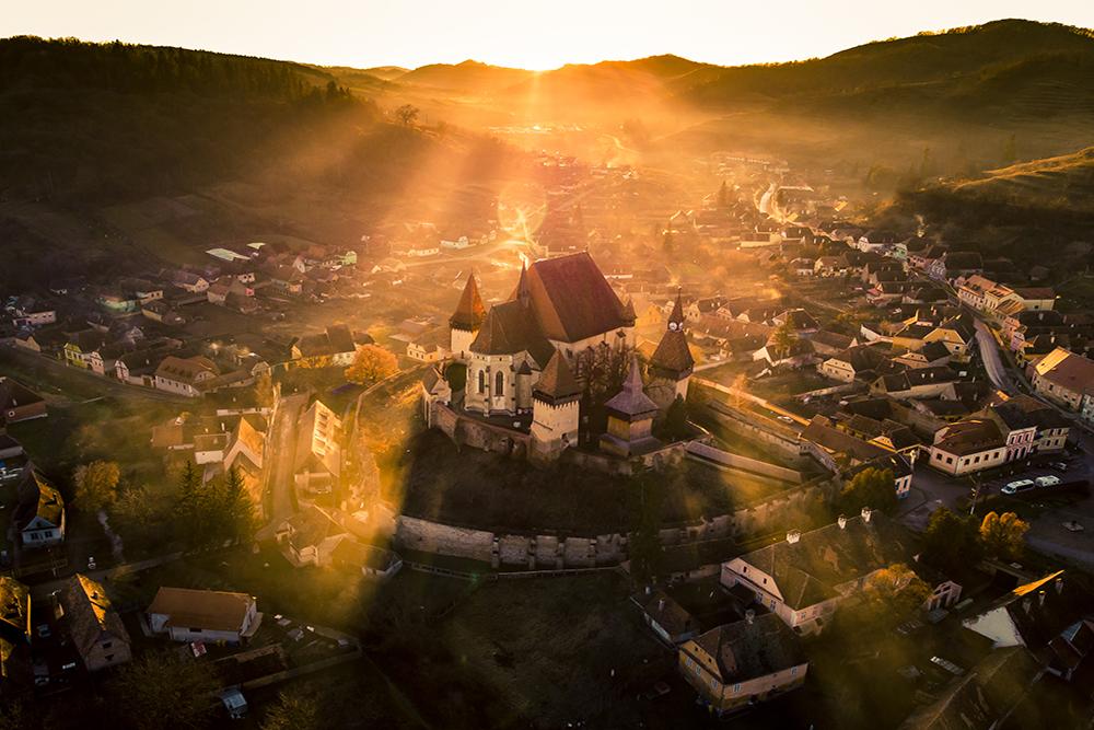 Mențiune. Patrimoniu cultural. Lozbă Tudor. Biertanul la apus (Biertan, jud. Sibiu)